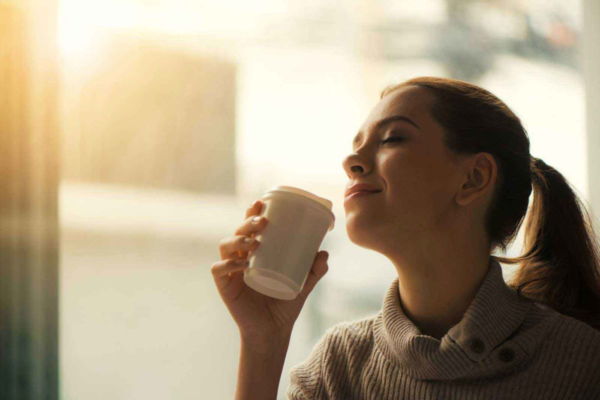 Woman enjoying a cup of coffee early in the day